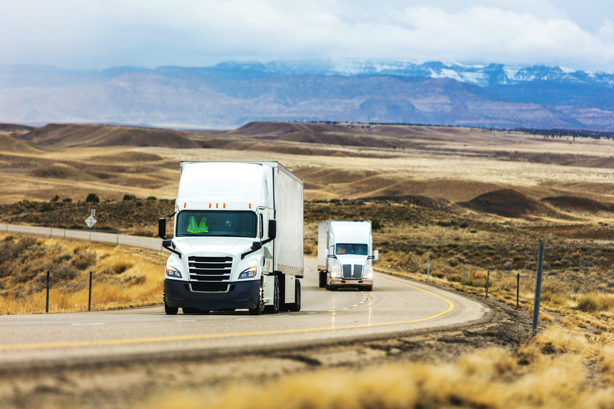 Cargo Transport Long Haul Semi Truck On a Rural Western USA Interstate Highway Delivering During Pandemic